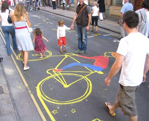 Street art incorporating double yellow lines