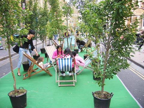 Street lounge with trees and deckchairs