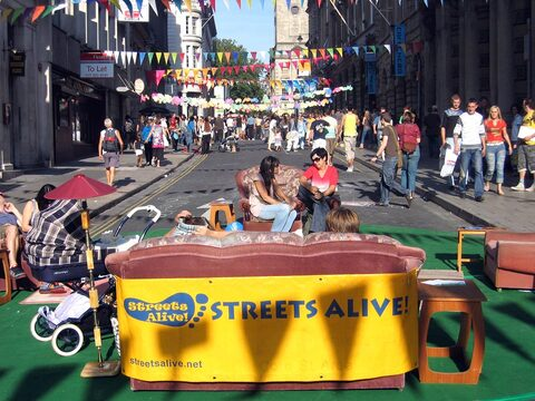 A street lounge with Streets Alive banner