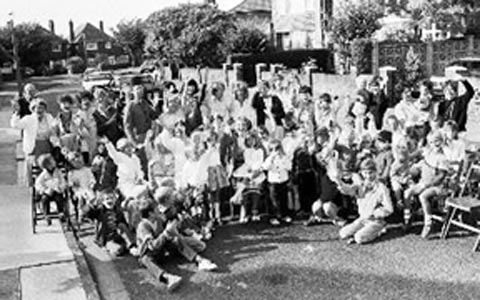 A black and white photo of a royal wedding street party in 1981