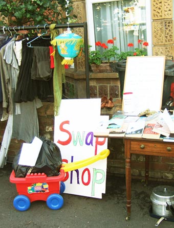 A street swap shop offering clothes, furniture and toys